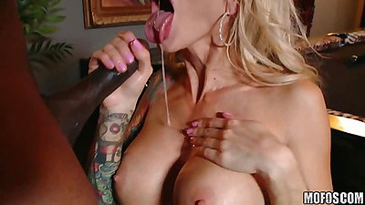 Black cock fills this busty milf throat