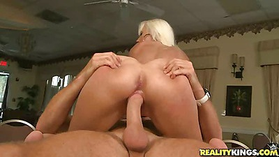 Blonde milf with pink ass sits on cock