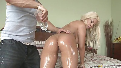 Bridgette gets her ass oiled and finger filled